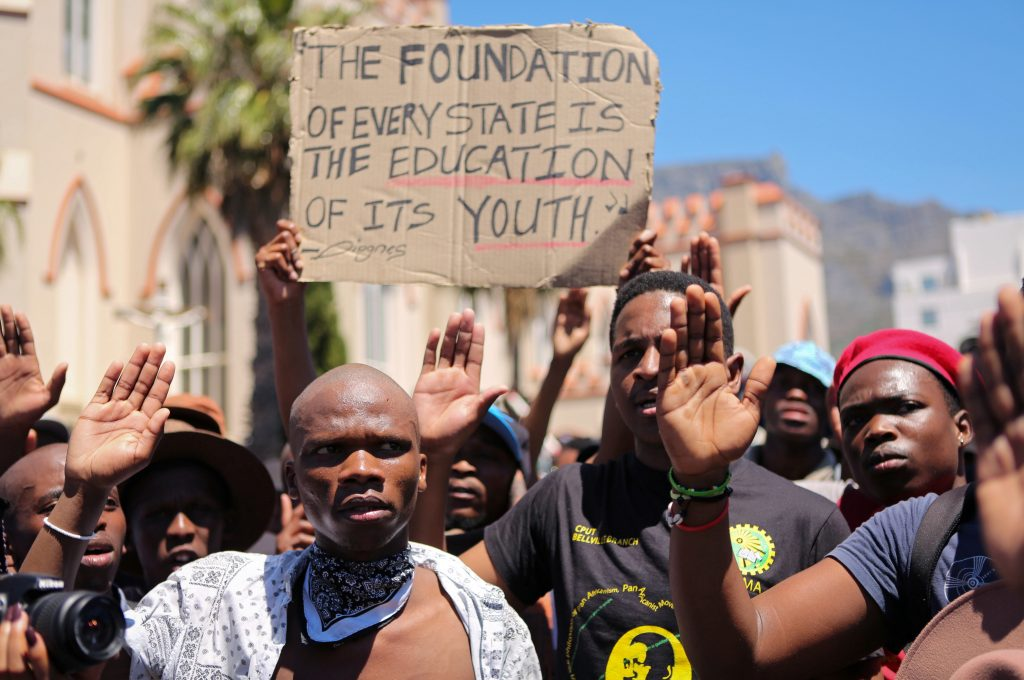 Students protest outside the parliament ahead of South African Finance Minister Pravin Gordhan's medium term budget speech in Cape Town, South Africa. Photo by Sumaya Hisham/Reuters