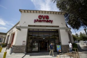People walk outside a CVS store in Pasadena, California. Photo by Mario Anzuoni/Reuters