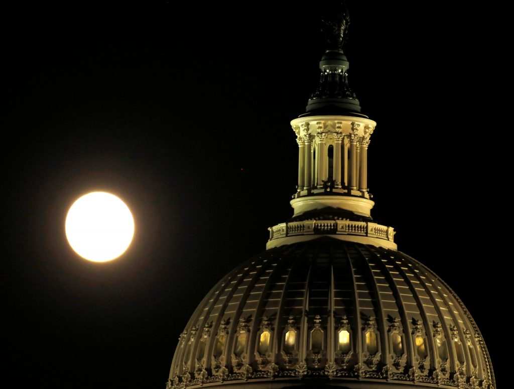 The supermoon rises over the United States Capitol dome in Washington, D.C. in November. Photo by Gary Cameron/Reuters