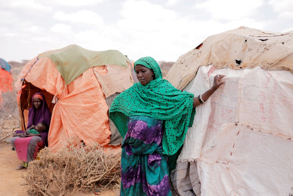 A nine-month pregnant displaced woman, Amina Ali, 23, stands beside her shelter at a makeshift settlement in Bardihahle near Burao, northwestern Togdheer region of Somaliland on March 26. She lost her livestock because of the drought. Photo by Zohra Bensemra/Reuters