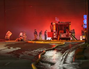 Emergency personnel work the scene of a bridge collapse at I-85 in Atlanta, Georgia