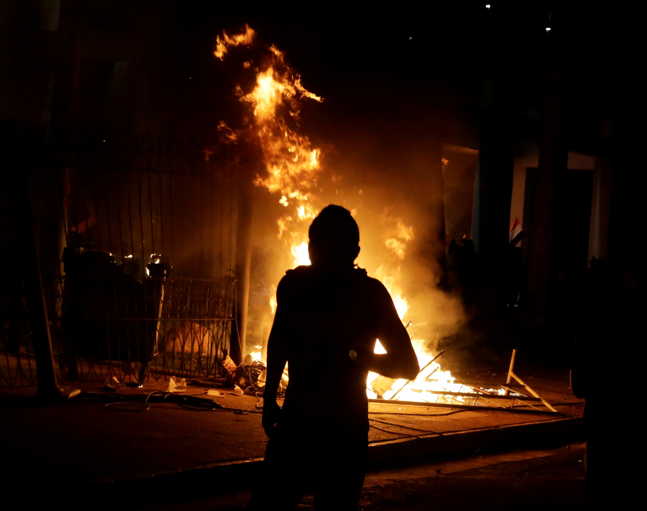 Protesters set fire to the Congress building during a demonstration against a possible change in law to allow for presidential re-election in Asuncion