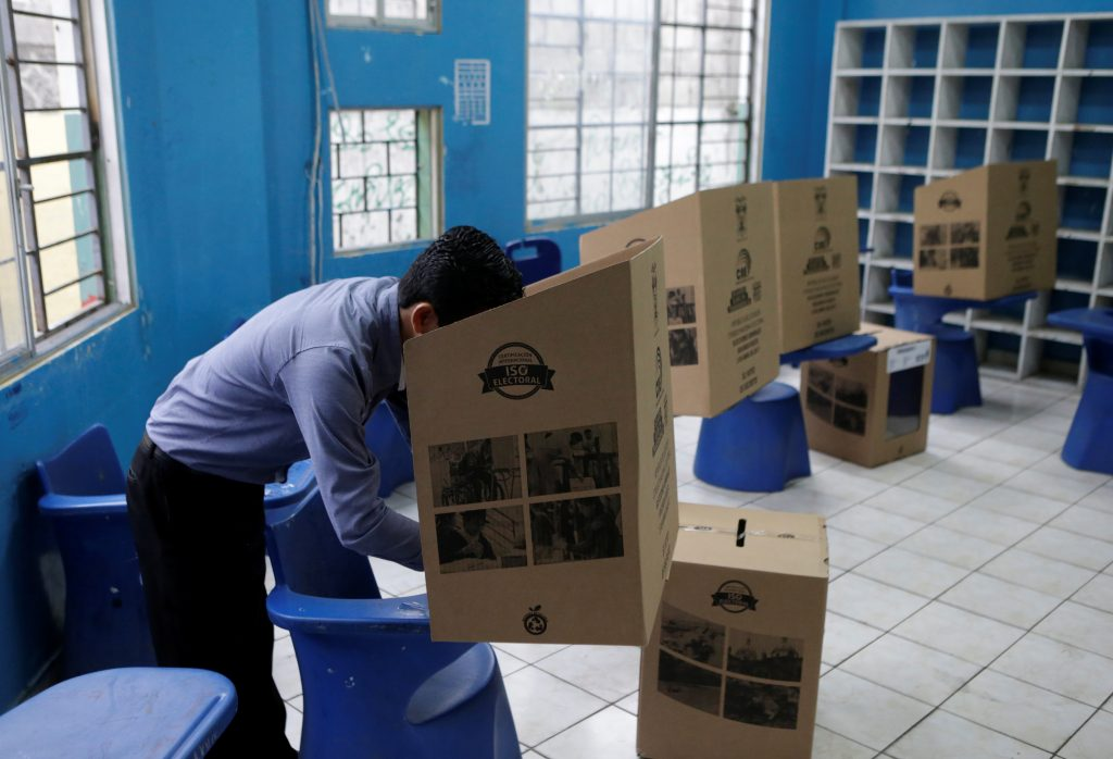 A man casts his vote in a school used as a polling station during the presidential election, in Guayaquil