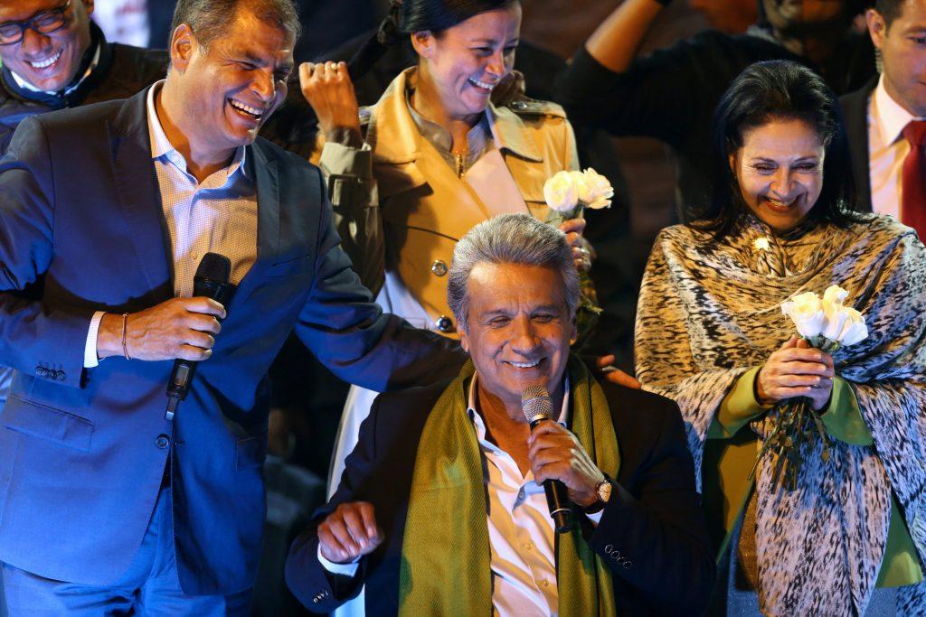Ecuadorean presidential candidate Lenin Moreno (center) celebrates alongside Ecuadorean President Rafael Correa (left) and his wife Rocio Gonzalez in Quito on April 2. Photo by Mariana Bazo/Reuters