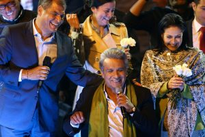 Ecuadorean presidential candidate Lenin Moreno (center) celebrates alongside Ecuadorean President Rafael Correa (left) and his wife Rocio Gonzalez in Quito on April 2. Photo by Mariana Bazo/Reuters