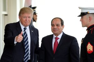 President Donald Trump gives a thumb's up with Egypt's President Abdel Fattah el-Sissi (right) at the White House on April 3. Photo by Carlos Barria/Reuters
