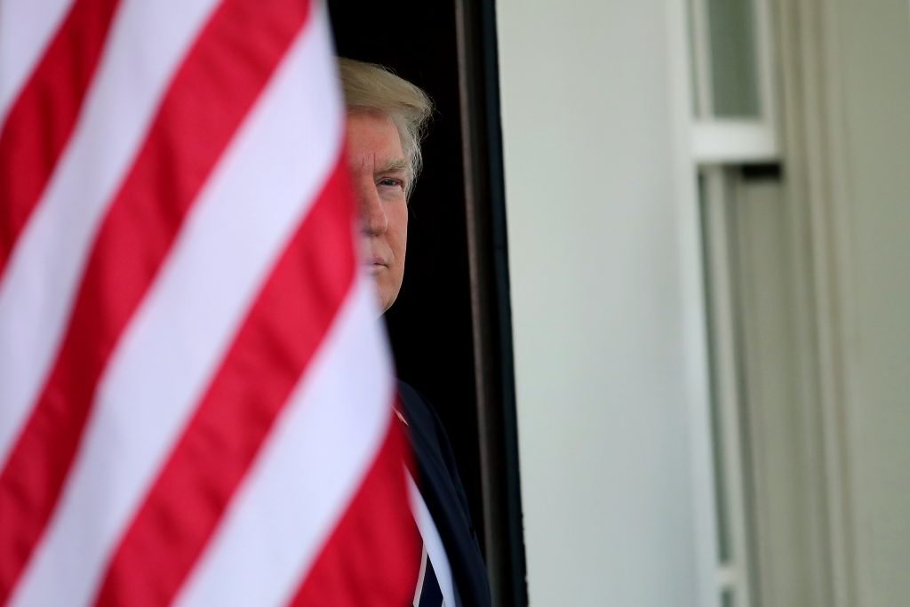 U.S. President Donald Trump waits for the arrival of Egypt's President Abdel Fattah al-Sisi at the White House in Washington, U.S., April 3, 2017. REUTERS/Carlos Barria TPX IMAGES OF THE DAY - RTX33W7D