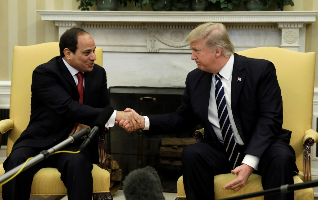 President Donald Trump (right) shakes Egyptian President Abdel Fattah el-Sissi's hand in the Oval Office of the White House on April 3. Photo by Kevin Lamarque/Reuters