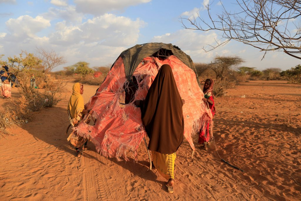 Somalis move their makeshift shelter closer to a water point at the Dollow camp. Photo by Zohra Bensemra/Reuters