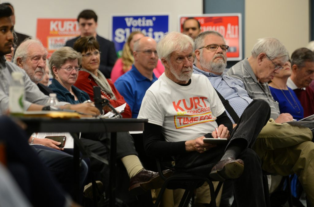 Residents and a wide variety of supporters listen to candidates speak during the League of Women Voters' candidate forum for Georgia's 6th Congressional District special election to replace Tom Price, who is now the secretary of Health and Human Services, in Marietta, Georgia, U.S. April 3, 2017. Picture taken April 3, 2017.  REUTERS/Bita Honarvar - RTX34SDX