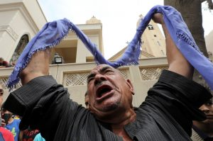 A relative of one of the victims reacts after a church explosion killed at least 21 in Tanta