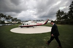 A members of the secret service walks by U.S. President Donald Trump's personal helicopter at Mar-a-Lago estate in Palm Beach, Florida, U.S., April 9, 2017. REUTERS/Carlos Barria - RTX34SOH