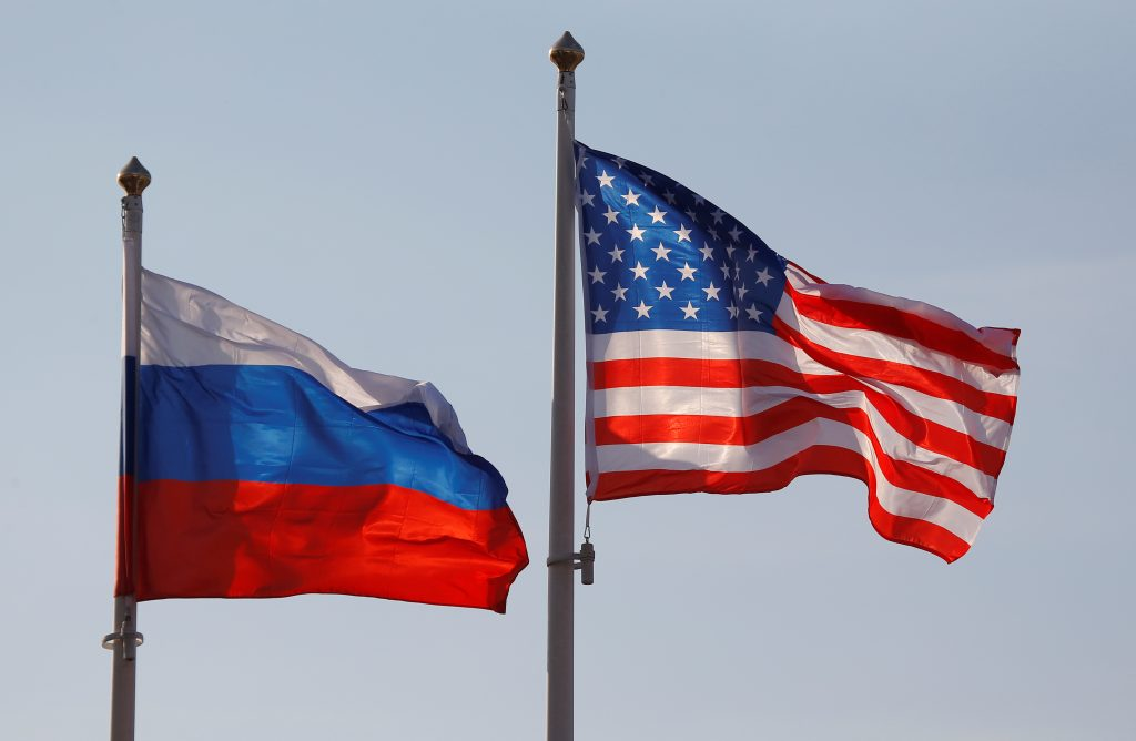 National flags of Russia and the U.S. fly at Vnukovo International Airport in Moscow, Russia. Photo by Maxim Shemetov/Reuters