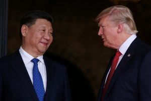 File photo of President Donald Trump (right) and Chinese President Xi Jinping by Carlos Barria/Reuters