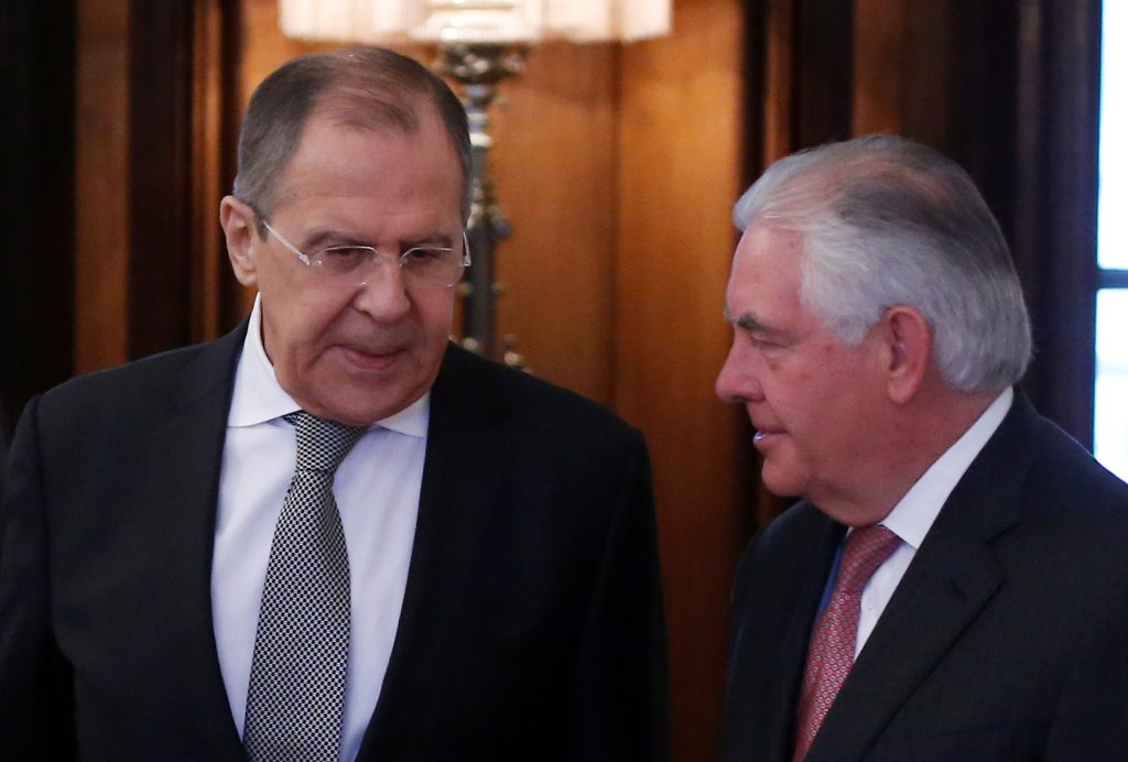 Russian Foreign Minister Lavrov and U.S. Secretary of State Tillerson enter hall during their meeting in Moscow