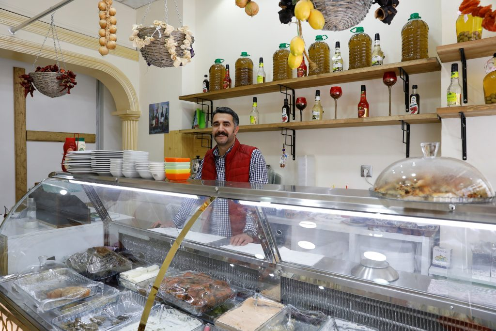 "NO: Restaurant owner Haluk Ozakin, 32, in his store in Diyarbakir says he was working for Diyarbakir municipality but was fired when pro-Erdogan parties took control of it. ""I will say 'No' because there is a war environment in this country. There is a lot of violent pressure on us. Erdogan is a cunning man. The people who are voting 'Yes' don't even know what are they voting for. Our biggest problem is the absence of democracy and this war environment."" Photo by Umit Bektas/Reuters"