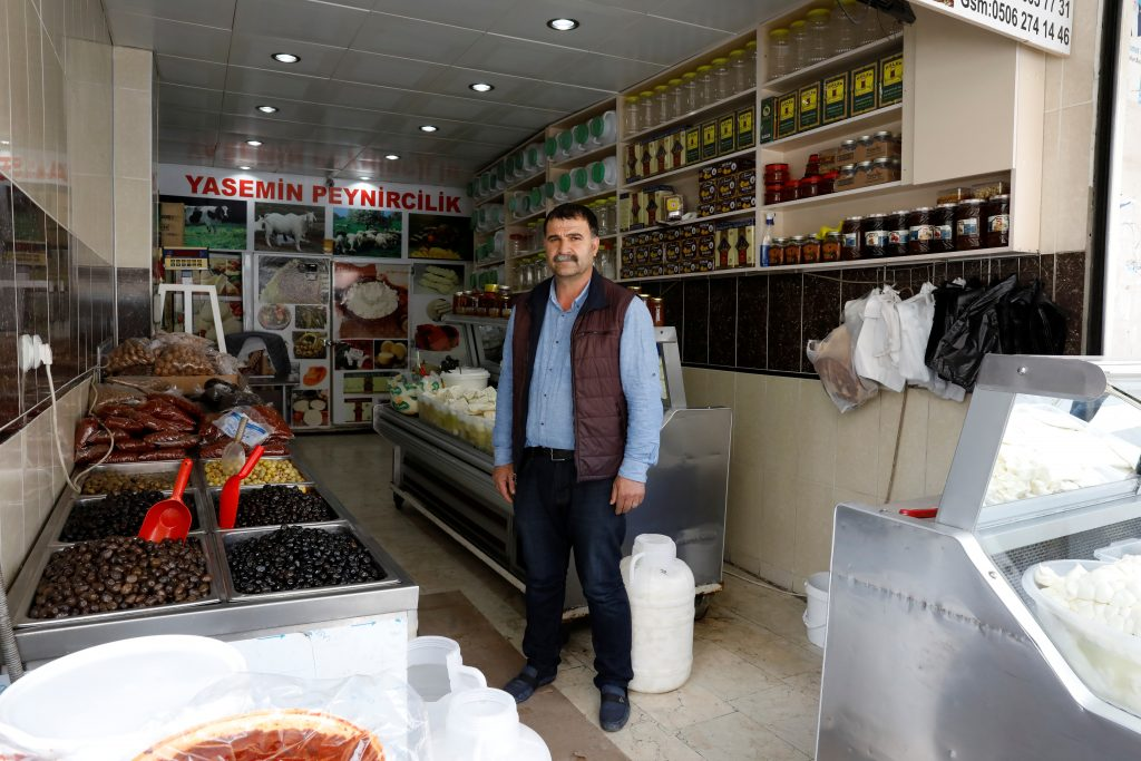 "YES: Food vendor Adil Aydin, 47, in his shop in Diyarbakir says, ""I will vote 'Yes' but it's not from my heart. I will vote 'Yes' because there isn't any leader who could rule better than Erdogan. In the past, other countries didn't care about what Turkey's leader said, but now they are all listening to Erdogan."" Photo by Umit Bektas/Reuters"