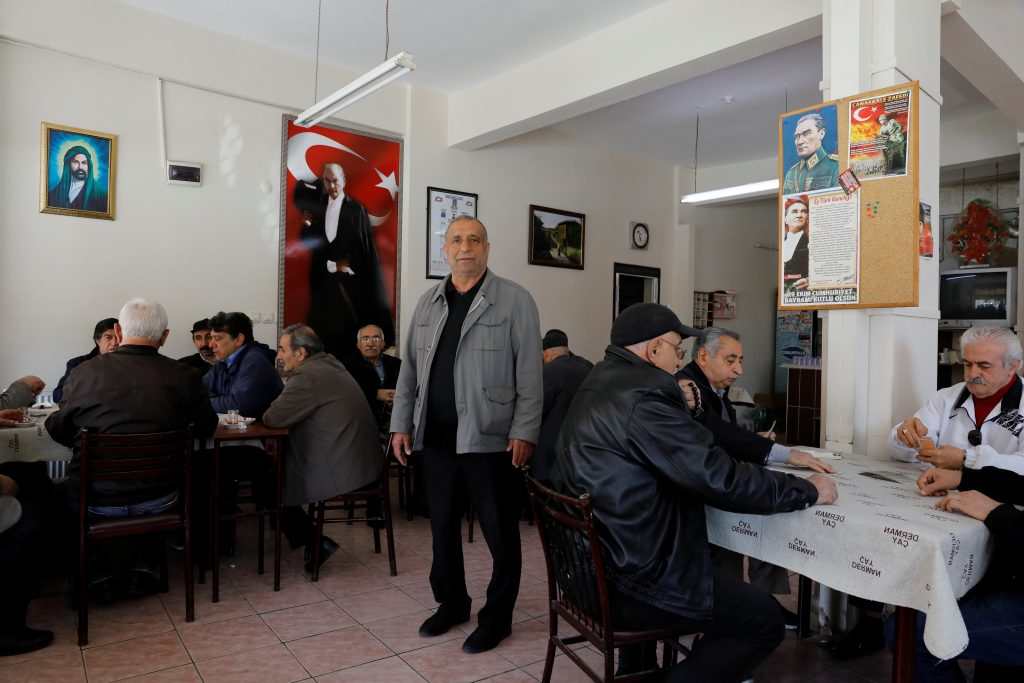 "NO: A retired manufacturer and head of an Alevi association Muzaffer Aksakal, 65, in Istanbul says, ""If the 'Yes' wins, parliament will be useless and the right to declare war or peace will be in the hands of a single man."" Aksakal belongs to the Alevi religious minority, which make up about 15-20 percent of Turkey's 80 million people. Alevis draw from Shiite, Sufi and Anatolian folk traditions and practice distinct rituals which can put them at odds with their Sunni Muslim counterparts, many of whom accuse them of heresy. ""Erdogan government always follows racist politics. Alevis are under pressure. The system ignores the Alevis."" Photo by Umit Bektas/Reuters"