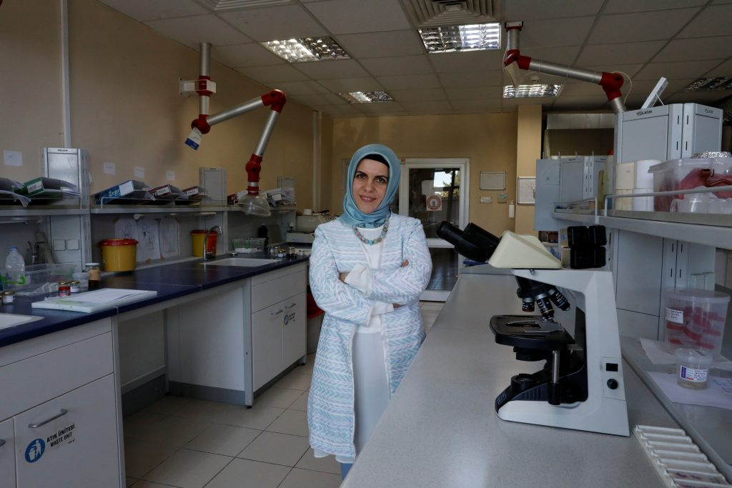 "YES: Associate professor of pathology, Dr. Sevdegul Aydin Mungan, 40, in her laboratory in a university hospital in Trabzon says, ""I am a humanist and a patriot. I had serious problems because of my headscarf while I was a student and then as an academic at the university hospital. I had friends wearing headscarves who left school and had mental problems. I am grateful to President Recep Tayyip Erdogan because under his rule I was aware again that I was human. I had the right to work with clothes that expressed my way of being. Erdogan is in love with his nation. If 'Yes' wins, we will become a more respectful and powerful country. But some countries are not comfortable with Turkey becoming more powerful."" Photo by Umit Bektas/Reuters"
