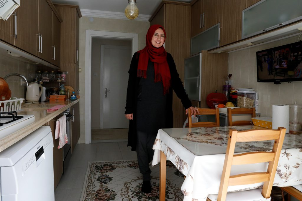 "YES: Housewife Pinar Ayyildiz Ozen, 41, in her kitchen in Cesme a town in Izmir province says, ""Erdogan is a reliable leader, he means a lot for Turkey. In the past, it was difficult to buy a washing machine. Now when one is broken, we buy a new one rather than have the old one repaired. If Erdogan rules for another 10 years, it would be good. Erdogan is the leader of the Muslim world."" Photo by Umit Bektas/Reuters"