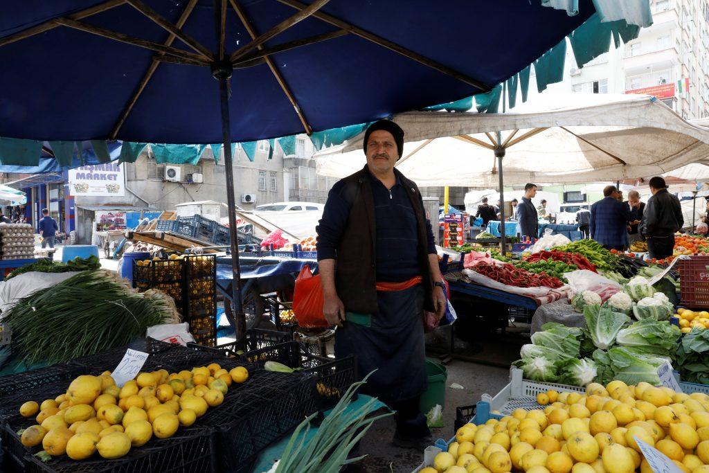 "YES: Street vendor Hikmet Gunduz, 52, in Diyarbakir says, ""I like President Erdogan's character. He is a bit angry and a bit authoritarian but his heart is full of love."" Photo by Umit Bektas/Reuters"