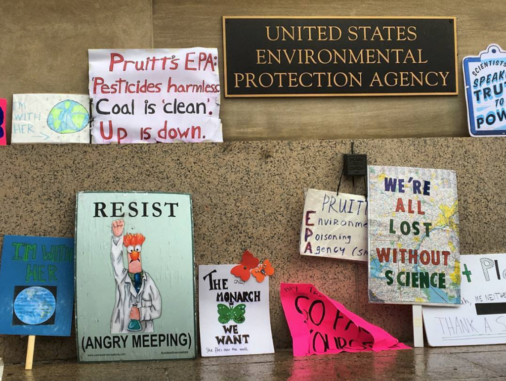As the March for Science wound down in Washington, D.C., people left posters outside the Environmental Protection Agency. (Photo by Nsikan Akpan)