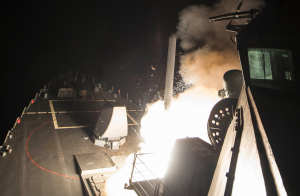 A cruise missile is launched from the deck of of the USS Ross in the Mediterranean Sea. The missile was one of around 60 that were launched to strike an airbase in Syria. U.S. Navy photo by Mass Communication Specialist 3rd Class Robert S. Price
