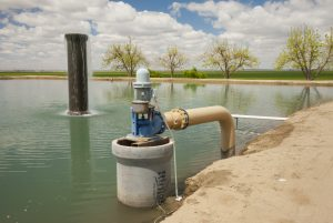 Groundwater pumping and storage system for agriculture, in California's Central Valley (San Joaquin Valley), Fresno County. Photo by