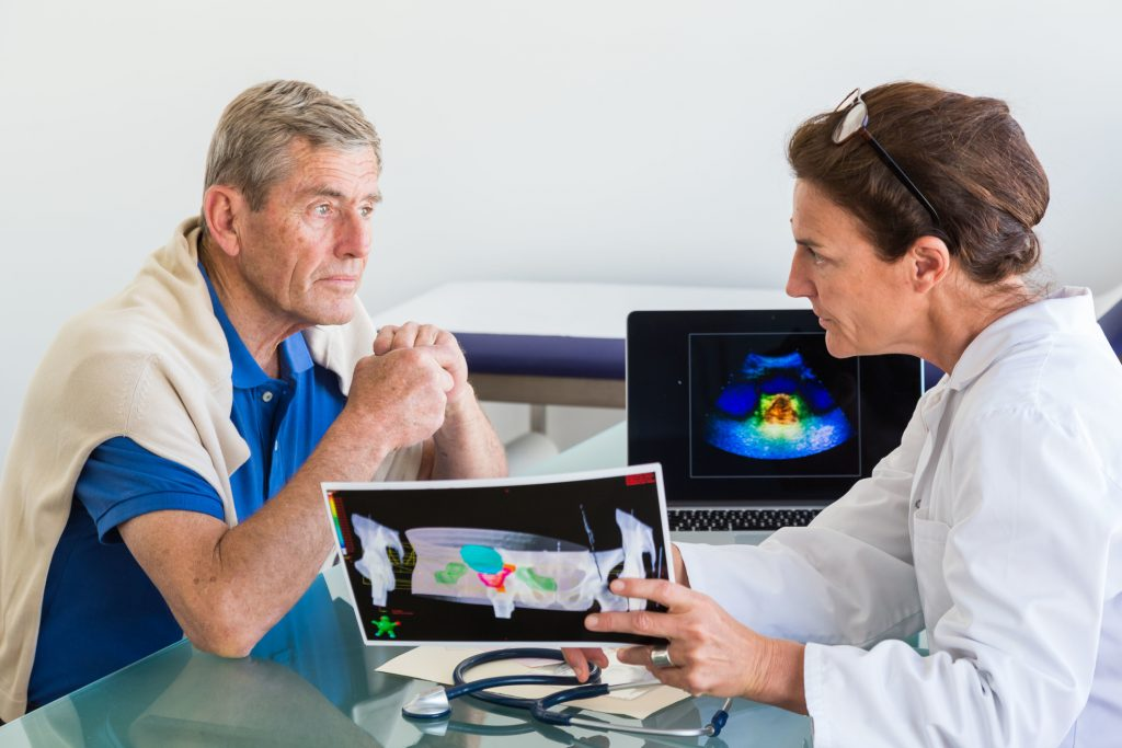 A doctor discusses prostate ultrasound scan with a patient. Photo by Getty Images.