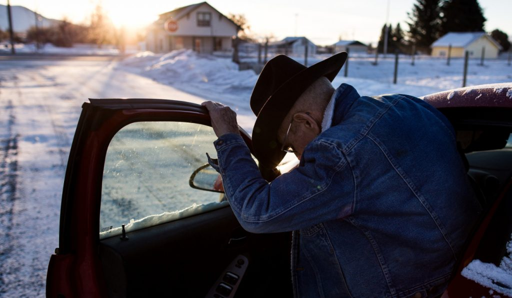 An Arco, Idaho, resident gets in his car after checking on nearby animals last month. Photo by M. Scott Mahaskey/Politico