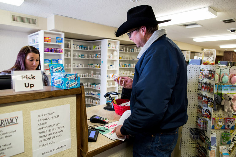 Shane Rosenkrance fills a prescription for his wife, Mimi, after she was discharged from Lost Rivers Medical Center following a cow-related injury. Photo by M. Scott Mahaskey/Politico