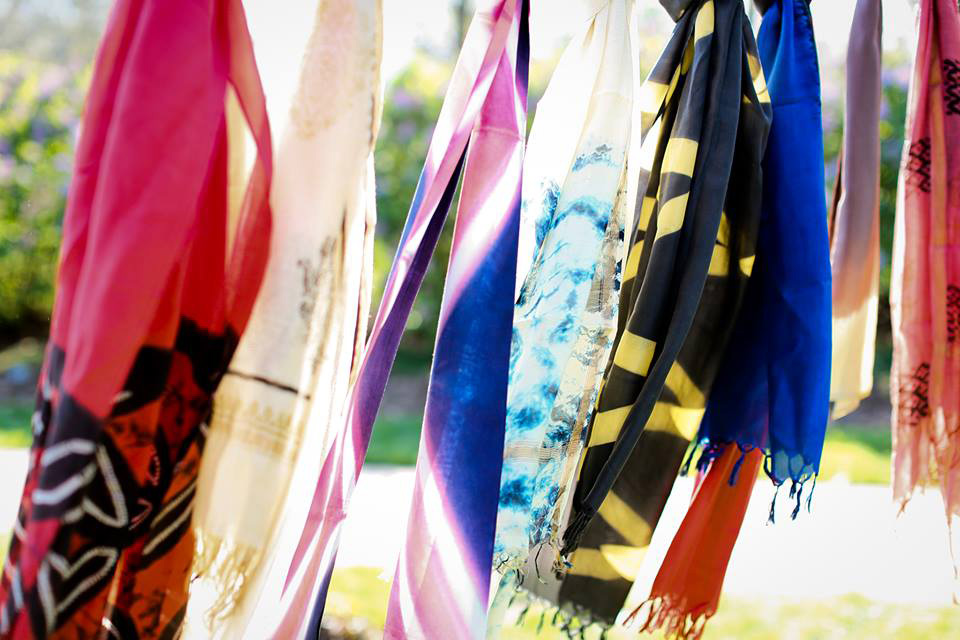 Artisans in India weave and use natural dyes to color the scarves. Photo courtesy of Lions in Four