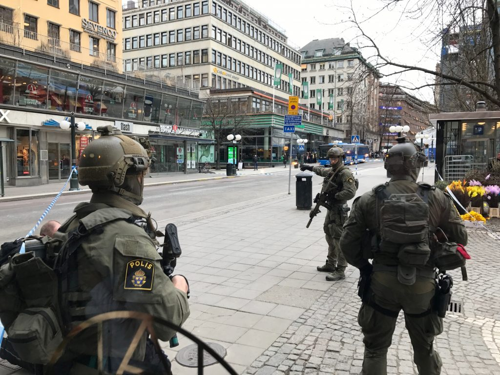 Sweden's police officers stand guard April 7 in central Stockholm, Sweden. Photo by REUTERS/Daniel Dikson.