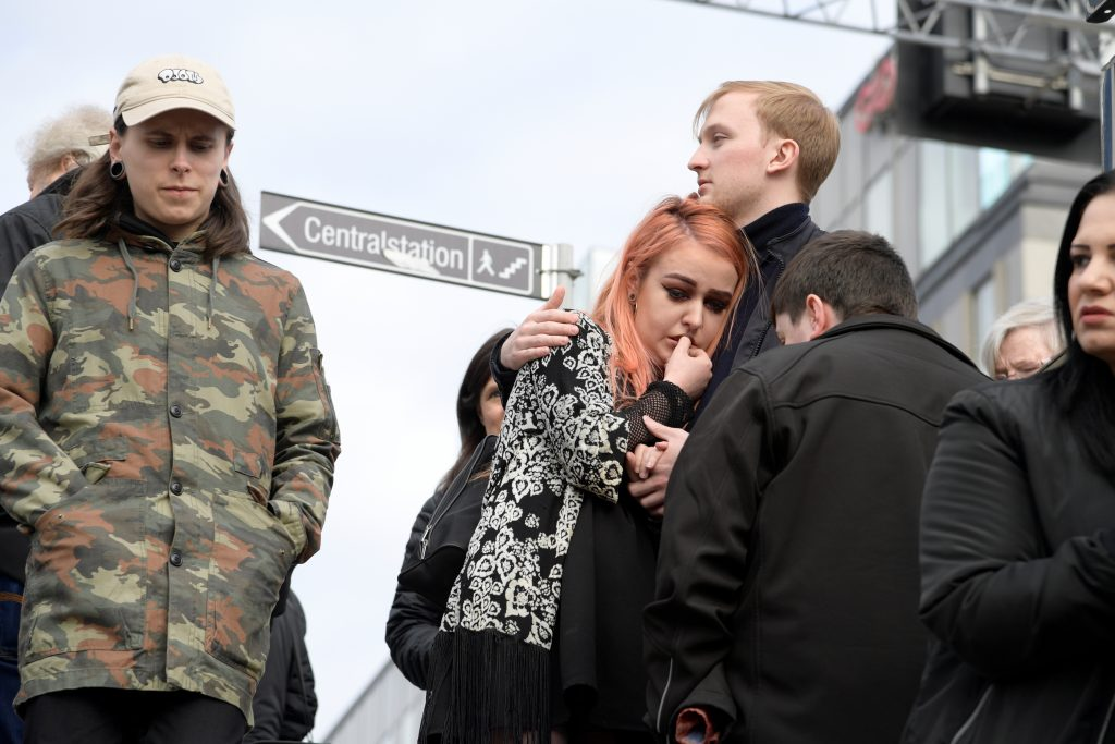Pedestrians react after at least two people were killed and many more injured when a truck crashed into a department store in central Stockholm, Sweden. Photo by TT News Agency/Anders Wiklund/via REUTERS.