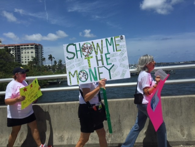Demonstrators march toward Mar-a-Lago Saturday in Palm Beach, Florida with many calling on Trump to release his tax returns.