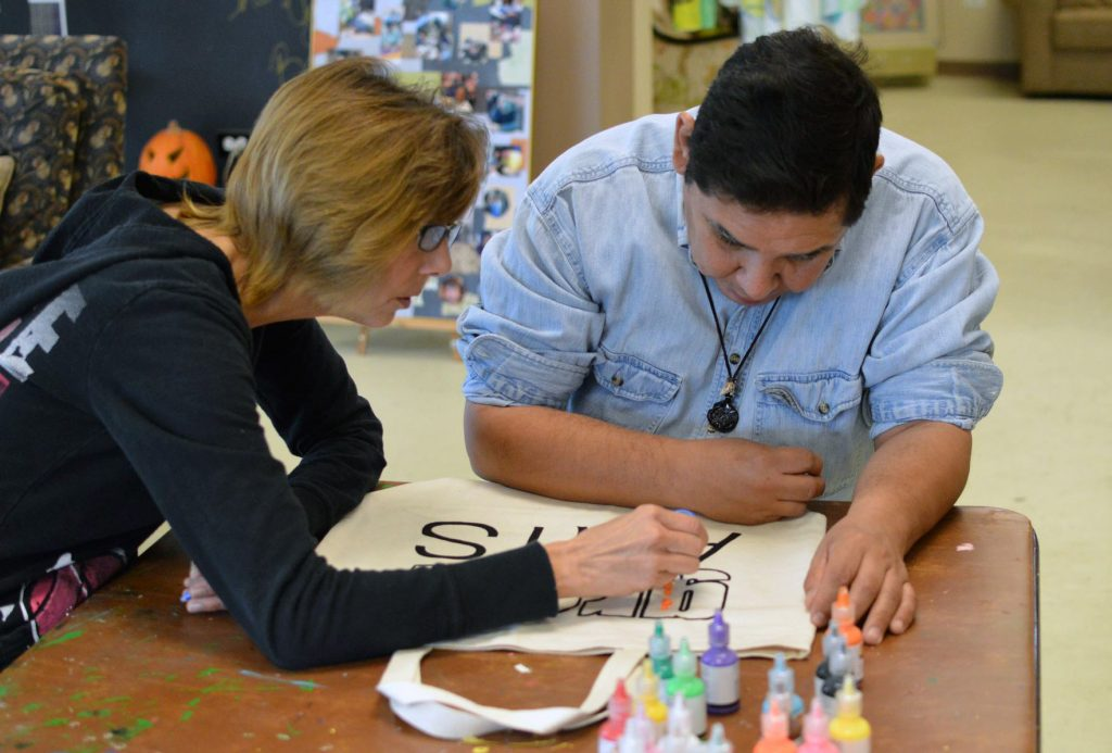 The growARTS program trains budding artists on expressing themselves through their work and meeting an audience of potential buyers. Photo courtesy of Garden Center Services