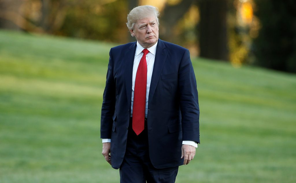 President Donald Trump walks from Marine One upon his return April 9 to the White House in Washington, D.C. Photo by REUTERS/Joshua Roberts.