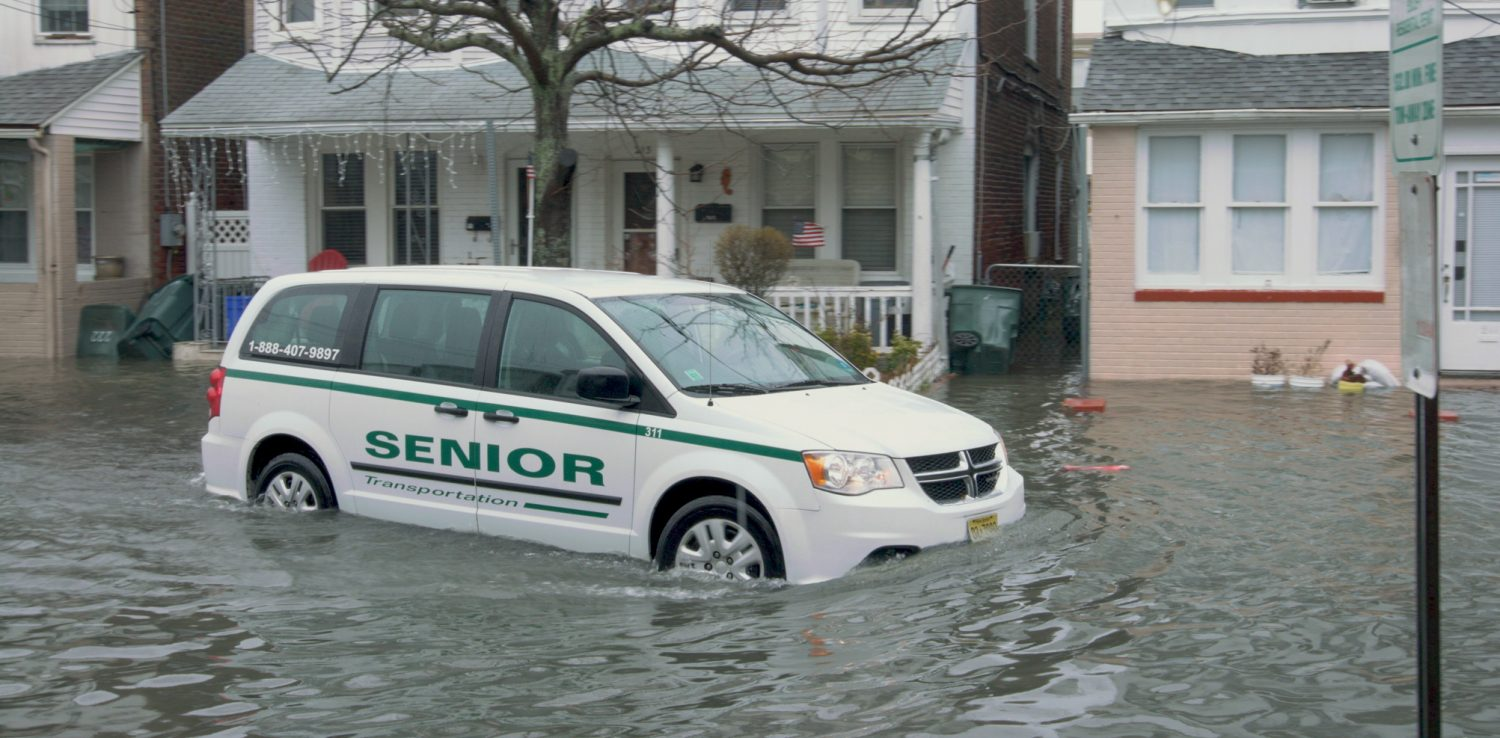 Cars and vans can create wakes when they're driven through floods in Atlantic City's bay neighborhoods. Photo by Ted Blanco/Climate Central