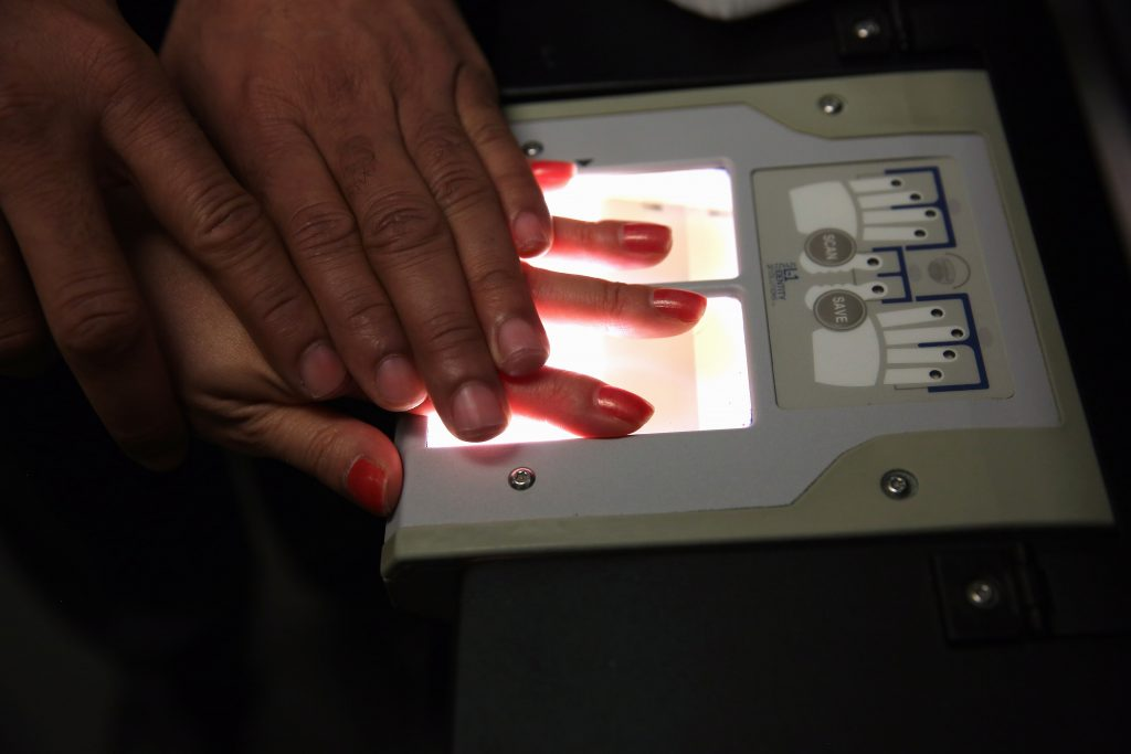 "NEW YORK, NY - MAY 30:  A Chinese immigrant is fingerprinted during her ""biometrics"" appointment to receive a green card at the U.S. Citizenship and Immigration Services (USCIS) Queens office on May 30, 2013 in the Long Island City neighborhood of the Queens borough of New York City. The branch office is located in an area heavily populated by immigrants and processes thousands of green card and U.S. citizenship applications each year.  (Photo by John Moore/Getty Images)"