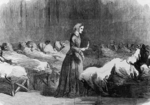 British nurse Florence Nightingale (1820 - 1910) makes her rounds in the Barrack hospital at Scutari, during the Crimean War, 24th February 1855