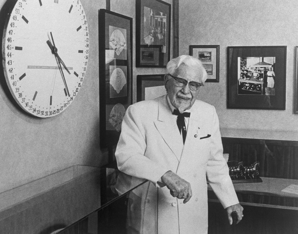 Colonel Harland Sanders, the founder of Kentucky Fried Chicken, is shown here as he celebrates his 88th birthday. Photo by Getty Images