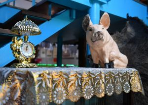 A gilded clock and plaster pig are among the items at the new Kitsch Museum in Bucharest, Romania. Photo by Daniel Mihailescu/AFP/Getty Images
