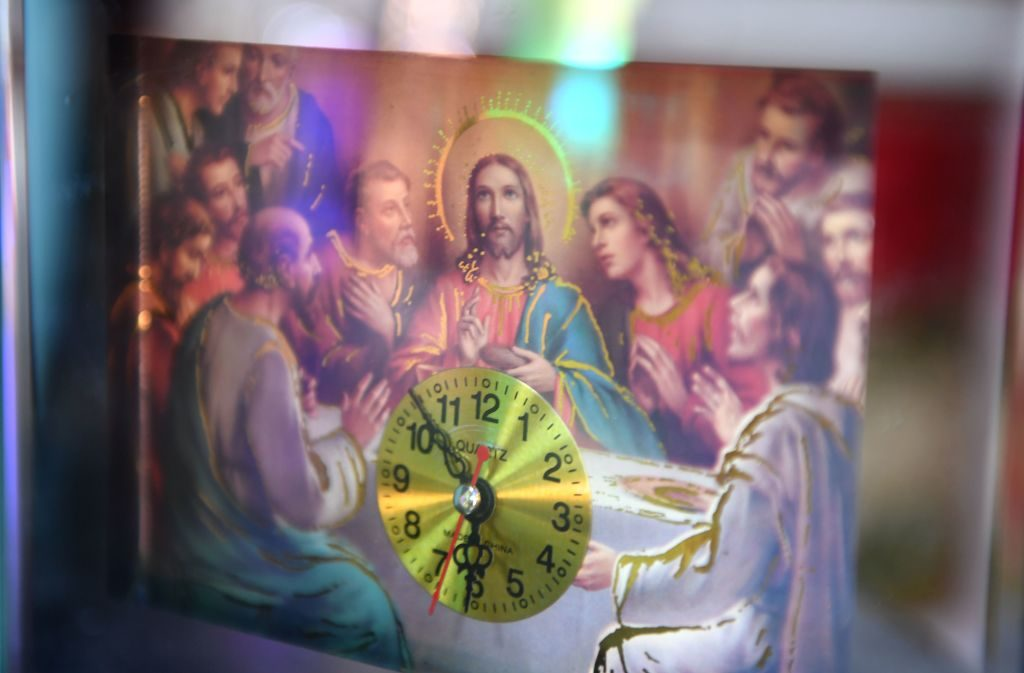 A table clock displays the Last Supper scene from the Bible. Photo by Daniel Mihailescu/AFP/Getty Images