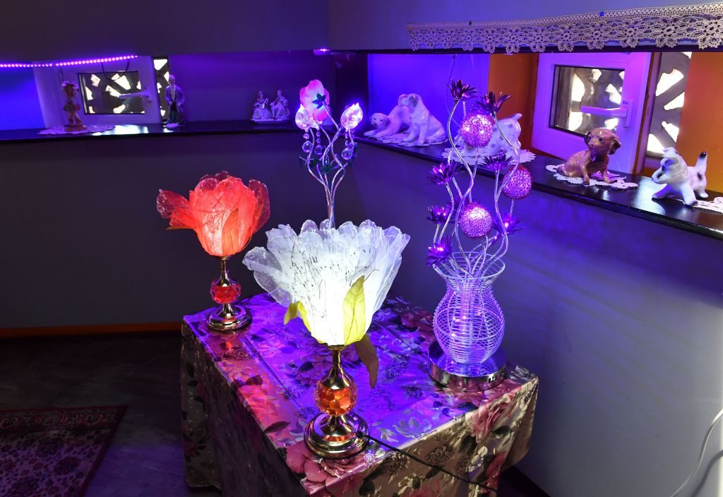 Items popular in communist era Romania include glowing flower lamps. Photo by Daniel Mihailescu/AFP/Getty Images