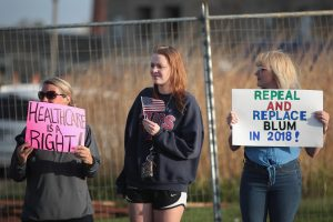 DUBUQUE, IA - MAY 08: Demonstrators protest outside of Dubuque Senior High School before the start of a town hall meeting with Congressman Rod Blum (R-IA) on May 8, 2017 in Dubuque, Iowa. The meeting is the first of four town hall meetings Blum has scheduled in his district this week. Many of the people at the event were angry with the changes the House of Representatives have made to the Affordable Care Act. (Photo by Scott Olson/Getty Images)