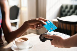 Woman using contactless payment, close up Photo by Tim Robberts/Getty Images