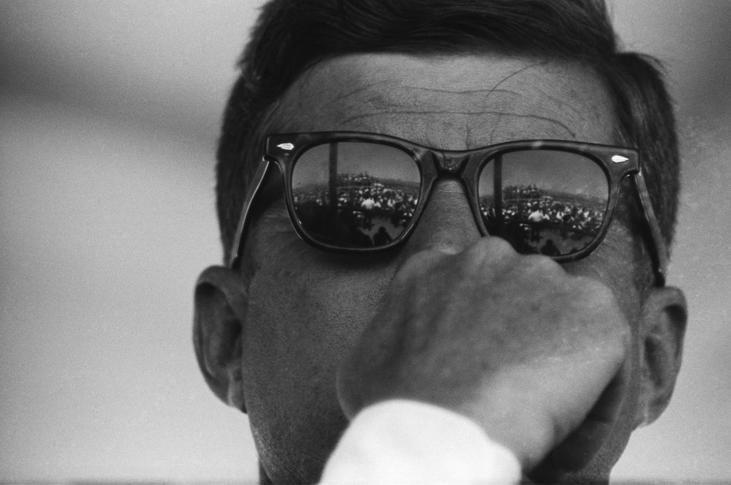 President John F. Kennedy reflects the crowd in his Ray Ban sunglasses during the groundbreaking ceremony for the Dan Luis Dam on August 18, 1962 on the Pacheco Pass between Los Banos and Gilroy, California . Photo by Michael Ochs Archives/Getty Images