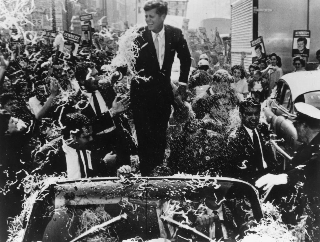 Senator John F Kennedy (1917 - 1963) is given a rousing ovation during his presidential campaign.   Photo by Keystone/Getty Images