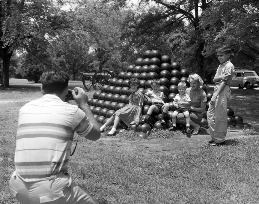 Stacked cannonballs form the backdrop for a family portrait at Shiloh National Military Park, July 1959. Photo by Jack E. Boucher/ National Park Service/via Flickr