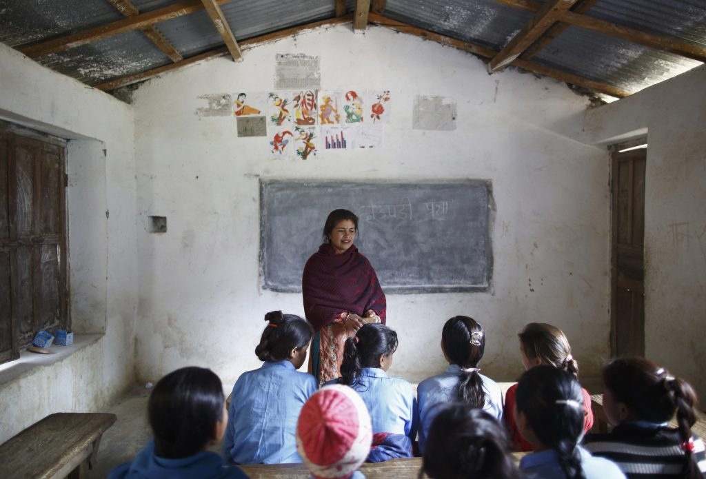 Rupa Chand Shah, a school teacher who does not support the practice of Chaupadi, teaches an awareness class at Shree Devi Mando School in the hills of Legudsen village in Achham District in western Nepal February 16, 2014. Chaupadi is a tradition observed in parts of Nepal, which cuts women off from the rest of society when they are menstruating. Photo by REUTERS/Navesh Chitrakar (NEPAL - Tags: SOCIETY) ATTENTION EDITORS: PICTURE 16 OF 20 FOR PACKAGE 'BANISHED ONCE A MONTH'  TO FIND ALL IMAGES SEARCH 'CHAUPADI' - RTR3G24U